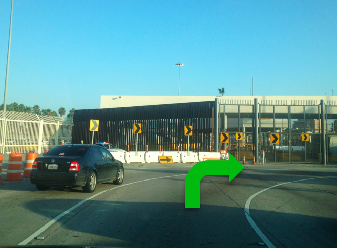 1. You'll approach the old border crossing. Follow traffic to make 90 degree right turn.