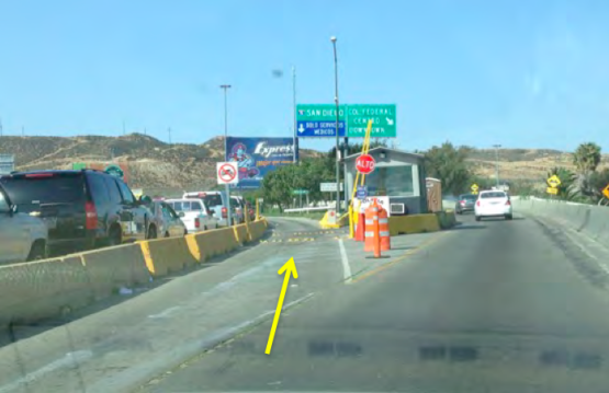 10. Once up the ramp, go to the LEFT when the road splits. You will stop at the booth to hand the officer your paperwork. Even if you see cones blocking off the entrance, it is not closed. Pull up and someone will come out of the booth.