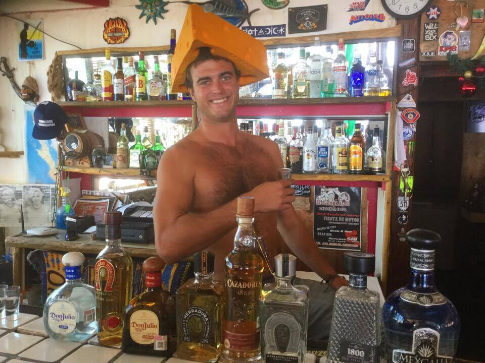 Nathan serves up the fun at the bar at Playa Buena Aventura